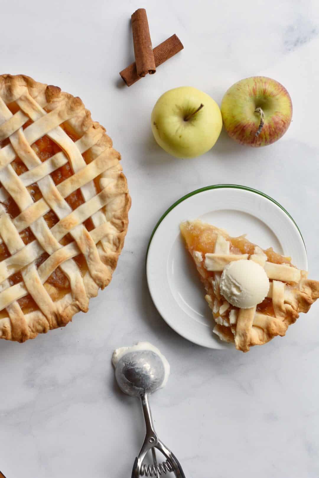 Overhead shot of homemade apple pie with ice cream.