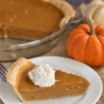 slice of pumpkin pie on plate with text