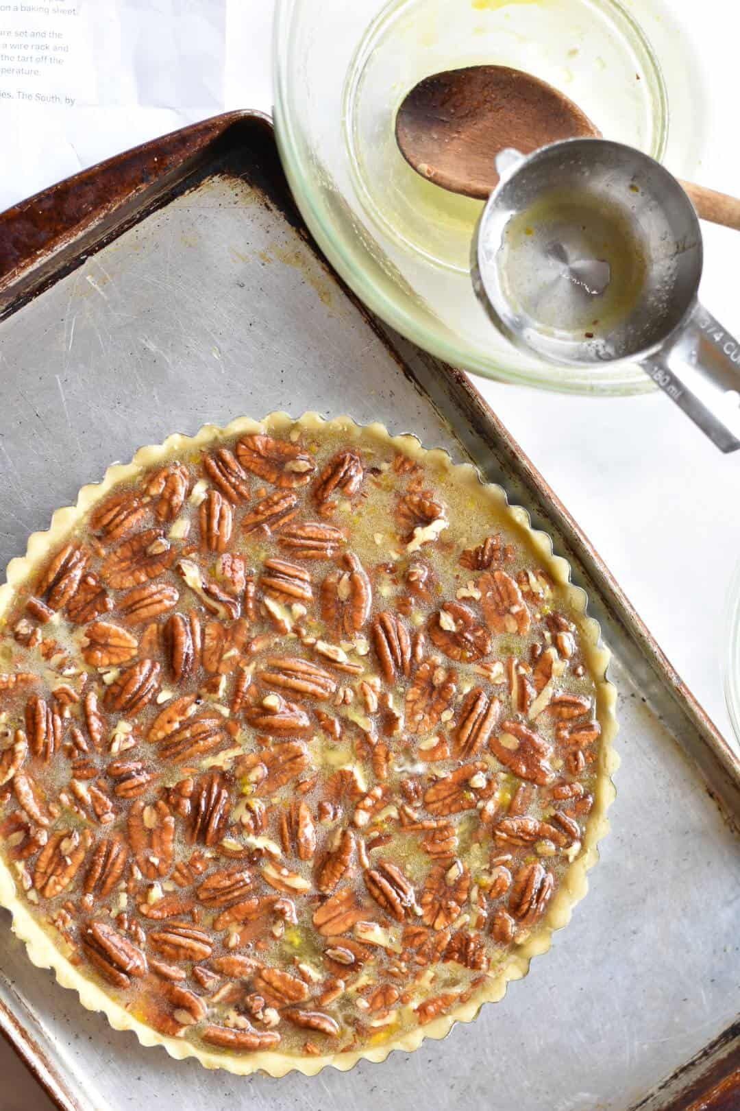 overhead shot of pecan tart before going in oven