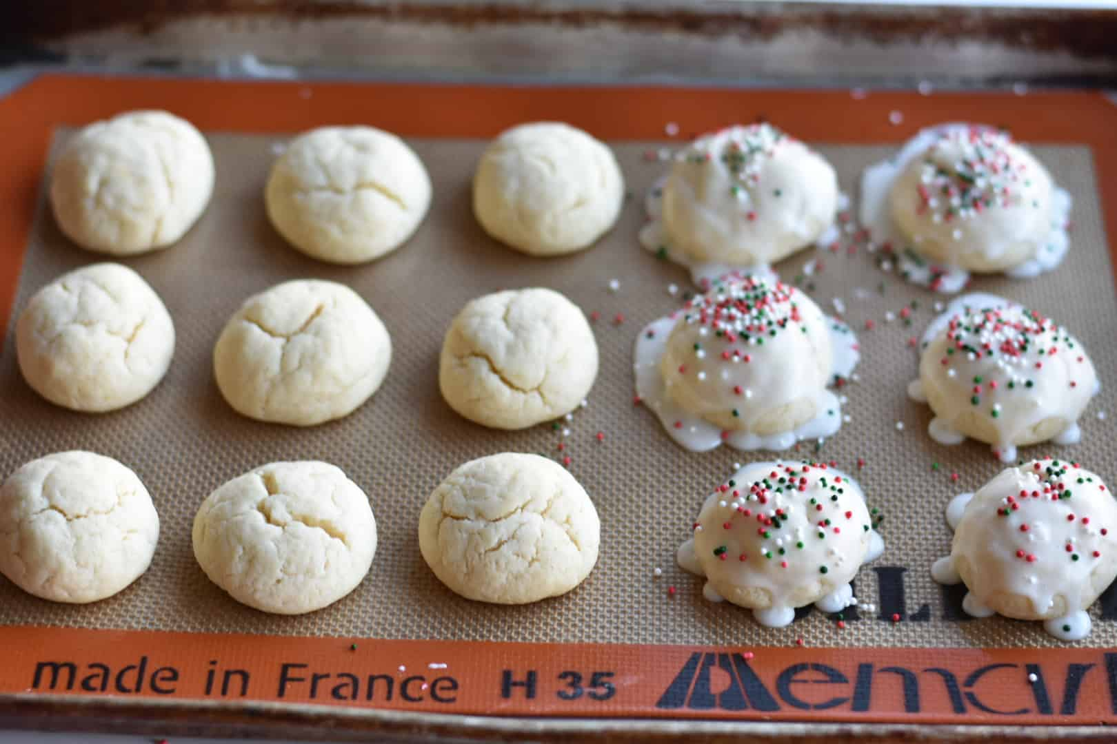 Frosted Italian Christmas cookies on a cookie sheet