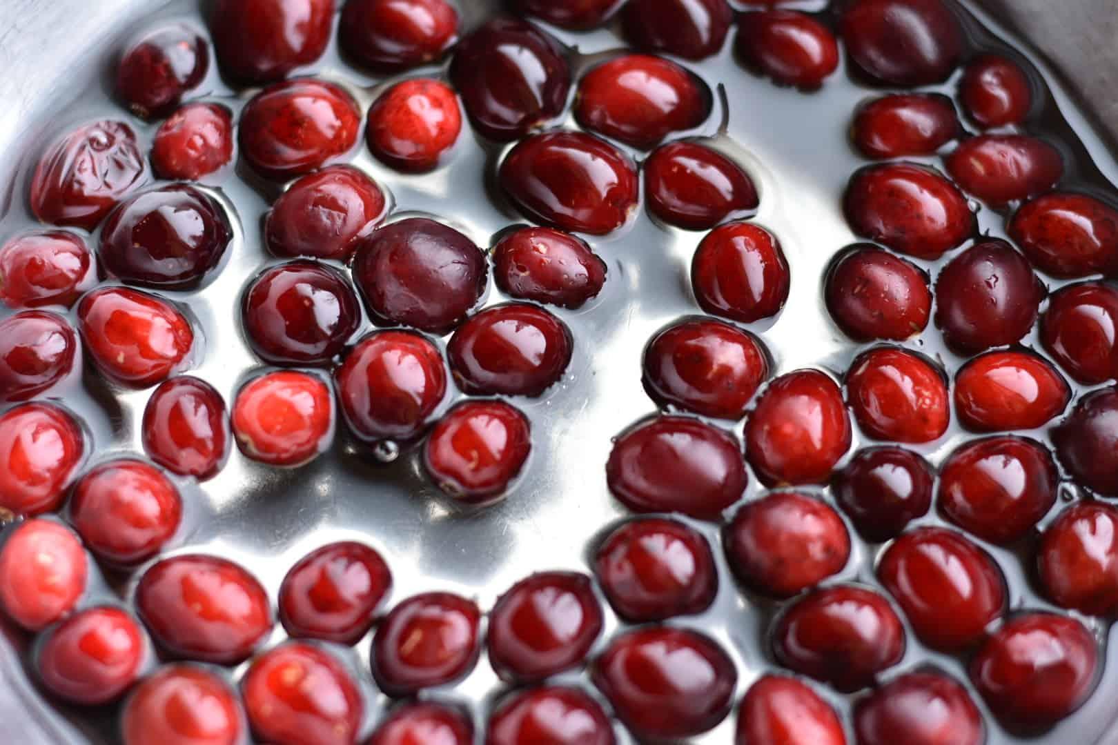 closeup of cranberries in sugar water