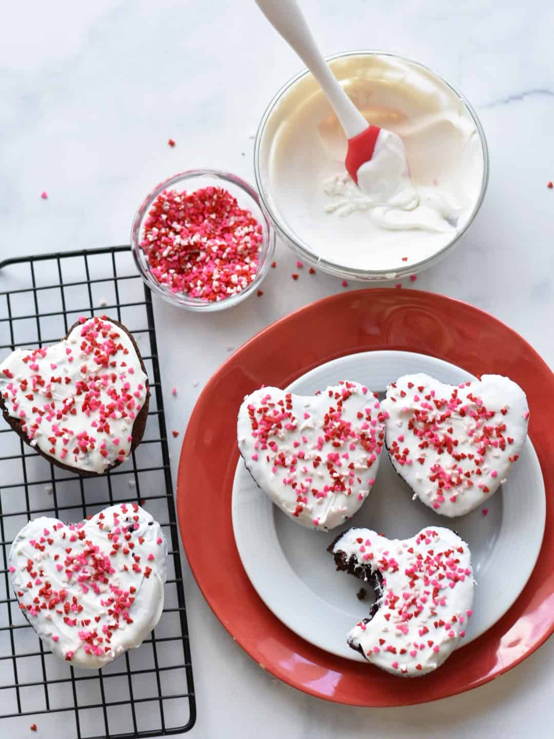 heart shaped brownies with bowl of melted white chocolate