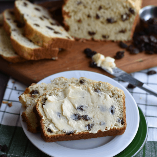 slice of irish soda bread on plate with butter