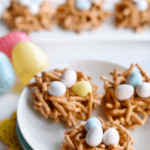 birds nest cookies on plate with pinterest text at top