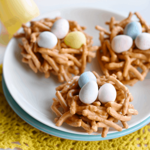 closeup of birds nest cookies on plate