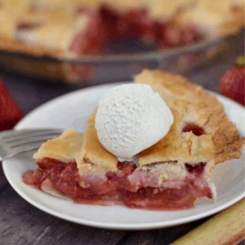 slice of strawberry rhubarb pie on plate