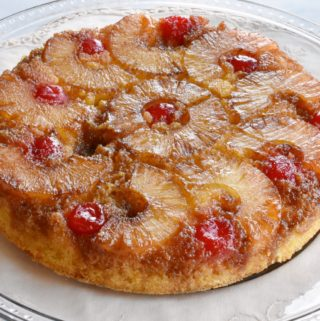 closeup image of a pineapple upside down cake on a cake