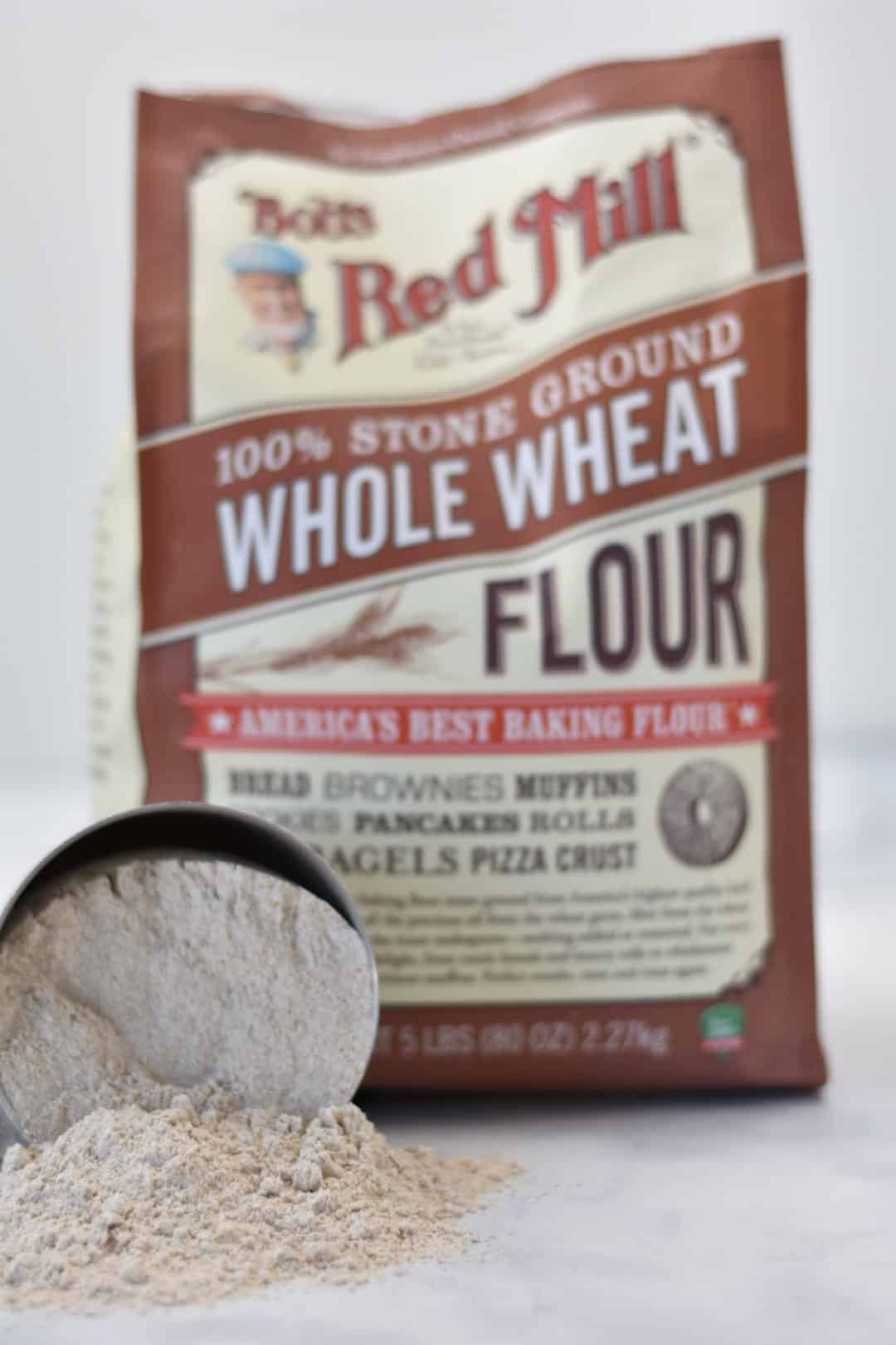 whole wheat flour in measuring cup