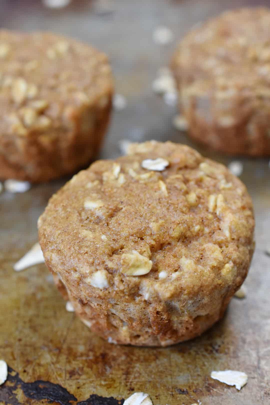closeup of oatmeal applesauce muffins on a baking sheet
