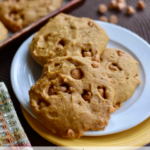 soft pumpkin cookies sitting on a plate