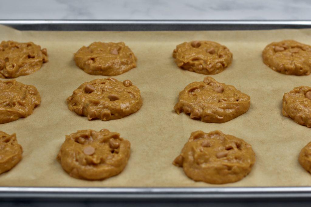 soft pumpkin cookies on a baking sheet