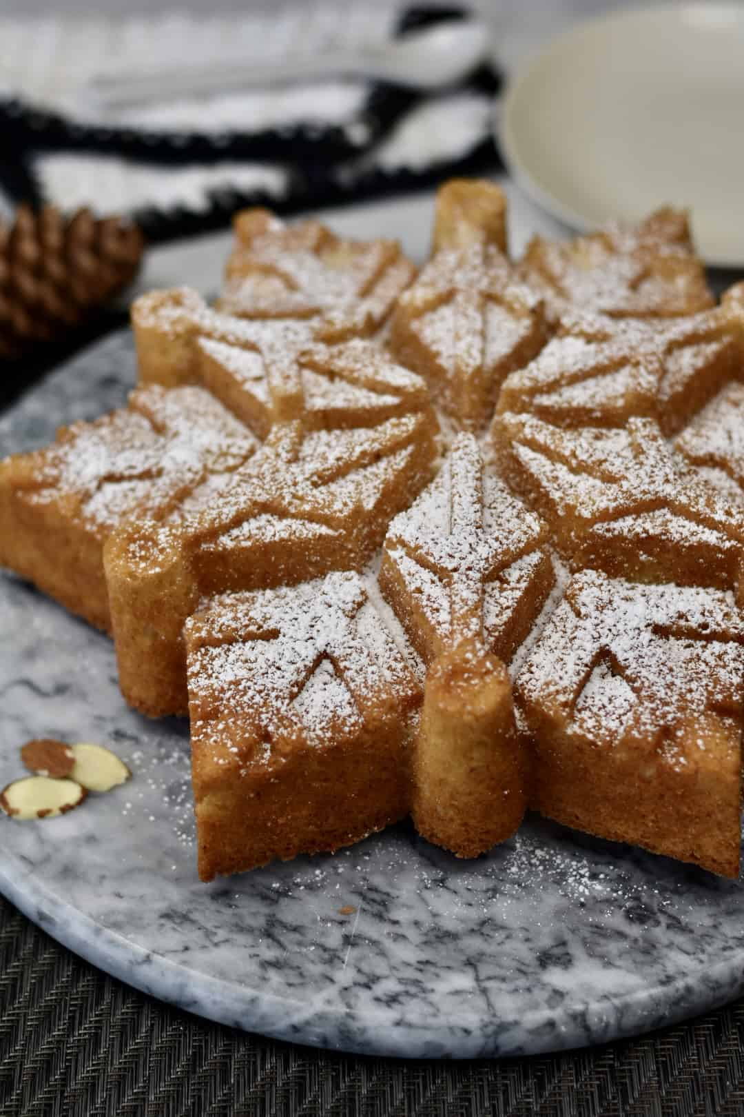 close-up of almond snowflake cake on a platter
