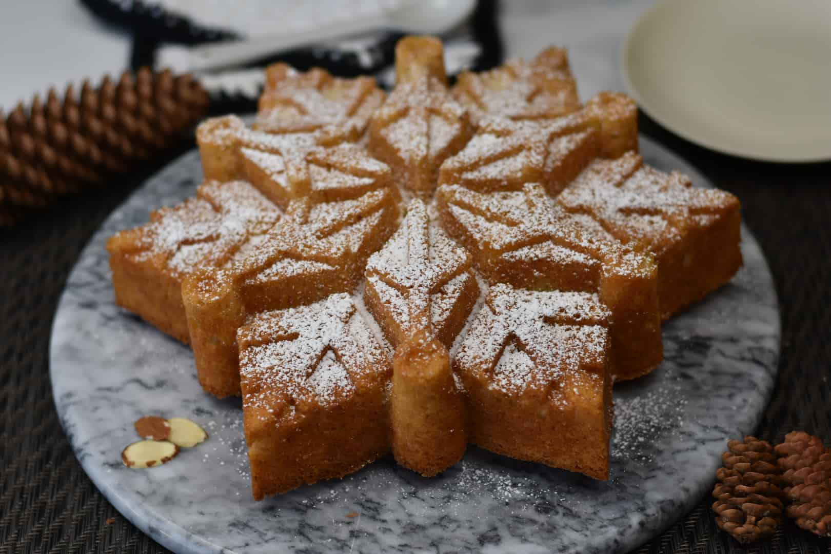 almond snowflake cake sitting on platter