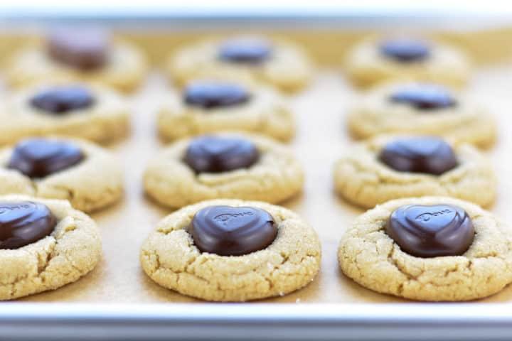 peanut butter heart cookies on baking tray