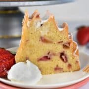 strawberries and cream bundt cake slice on a plate