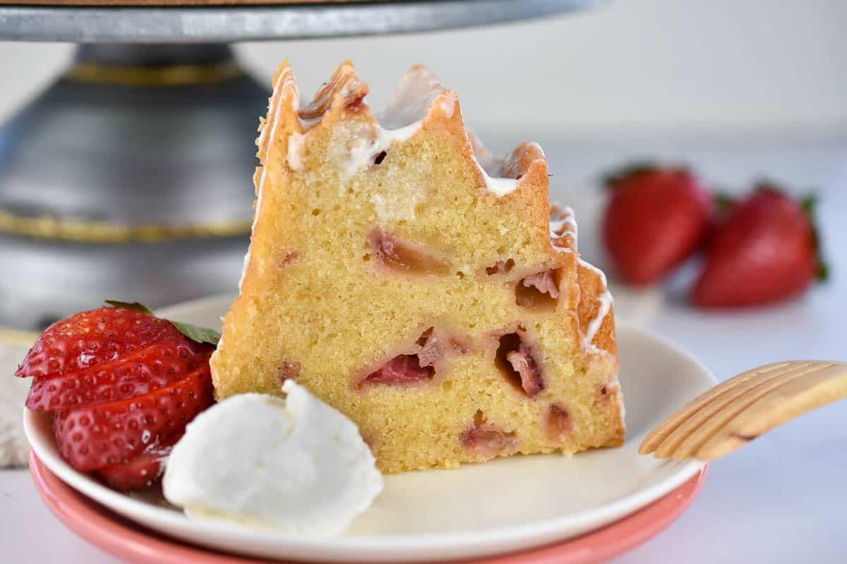 strawberries and cream bund cake slice with whipped cream