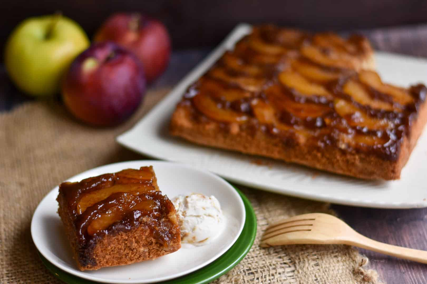 closeup image of apple cinnamon upside down cake slice on a plate with a fork