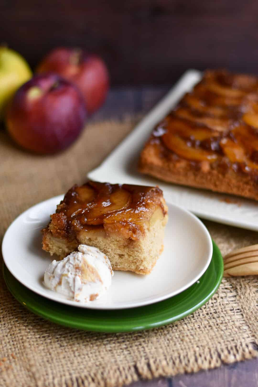slice of apple cinnamon upside down cake on a plate with ice cream