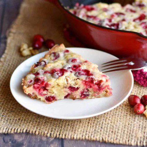 closeup of almond cranberry cake slice