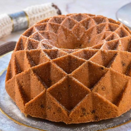 closeup image of black walnut pound cake on platter