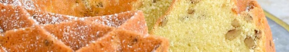 image of black walnut pound cake on platter with slice in the background