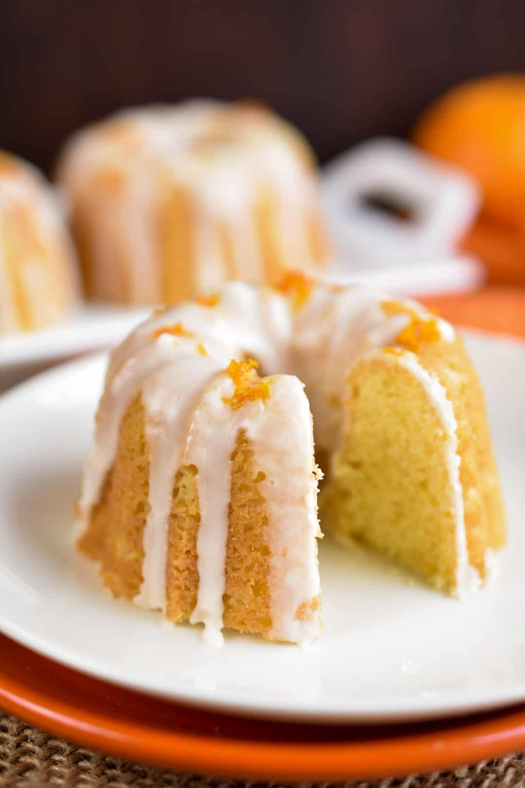 closeup of mini bundt cake with slice out sitting on a plate