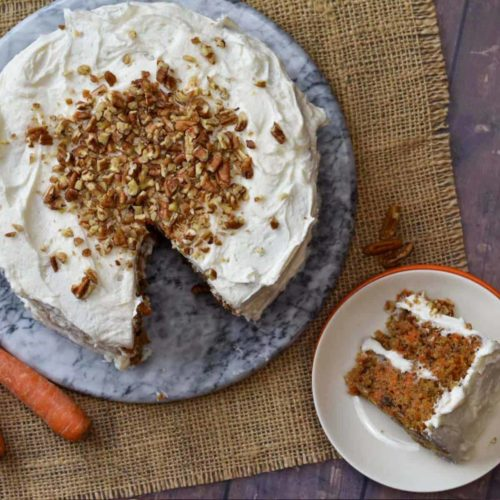 overhead shot of pecan carrot cake with a slice on a plate