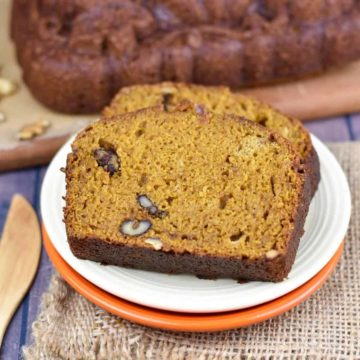 closeup of two slices of pumpkin walnut bread on a plate
