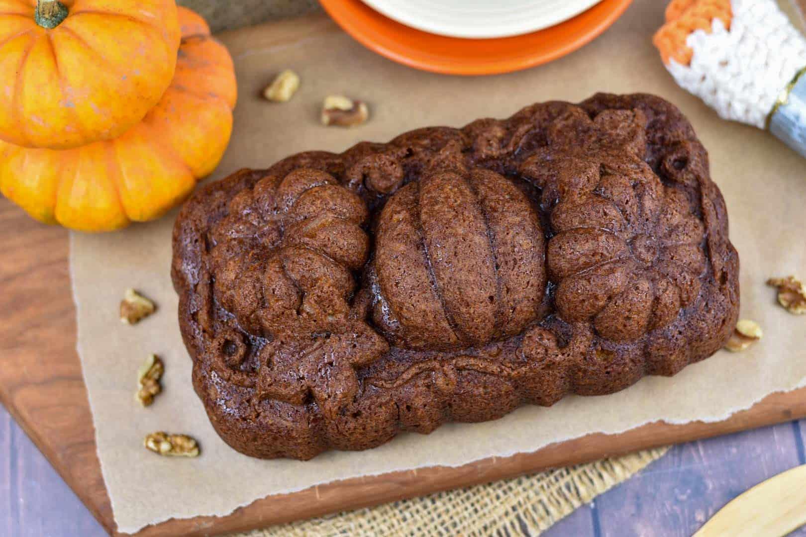 overhead shot of pumpkin walnut bread on cutting board